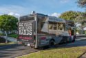 Image of Made In Brooklyn food truck parked next to green lawn
