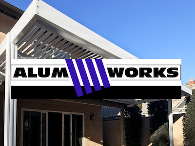 Alum Works logo against a white patio attached to a stucco house